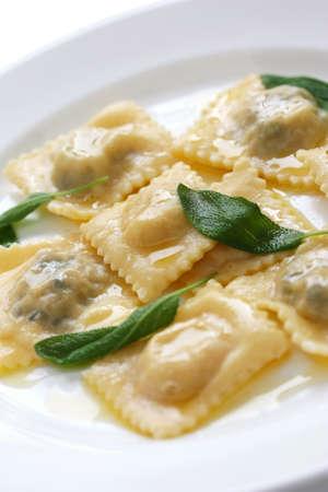 homemade ravioli pasta with sage butter sauce , italian food photo