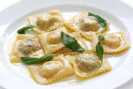 ravioli: homemade ravioli pasta with sage butter sauce , italian food