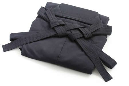 aikido: folded aikido hakama , japanese martial arts uniform
