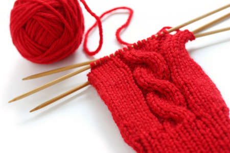 balls of yarn: knitting image, a red yarn ball with noodles
