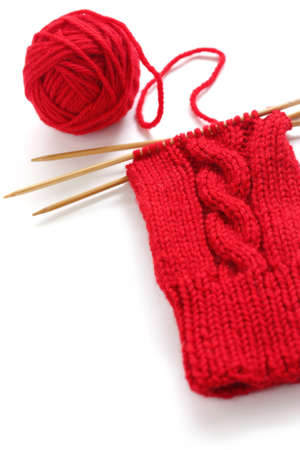 knitting image, a red yarn ball with noodles photo