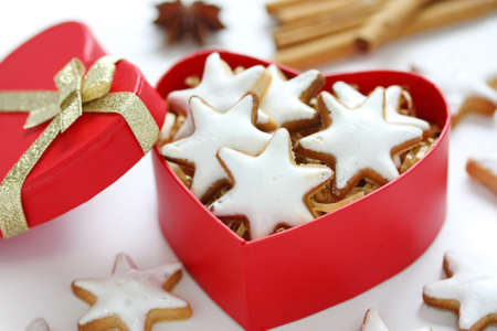 star shaped: Zimtstern , homemade christmas cookies in a red heart shaped box