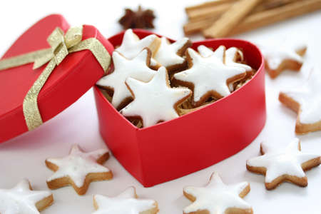 Zimtstern , homemade christmas cookies in a red heart shaped box photo