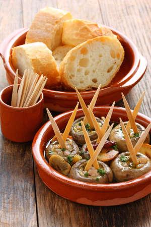 toothpick: champinones al ajillo , garlic mushrooms , spanish tapas dish Stock Photo
