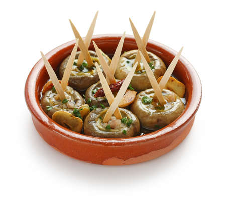 cazuela: champinones al ajillo , garlic mushrooms , spanish tapas dish Stock Photo