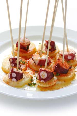 タコのガリシアのスタイル (ガリシア)、スペインのタパス料理 写真素材