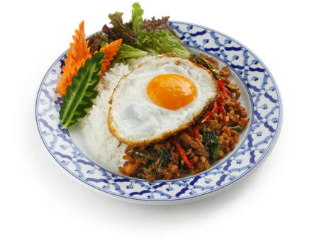 stir fried chicken with holy basil , gai pad bai gaprow , thai cuisine photo