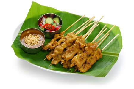 banana leaf: moo satay, pork satay, thai cuisine Stock Photo
