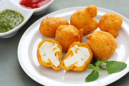 vegetarian cuisine: cauliflower pakora, indian fritter cuisine Stock Photo