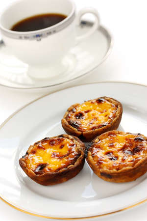egg tart: homemade egg tart and a cup of coffee Stock Photo