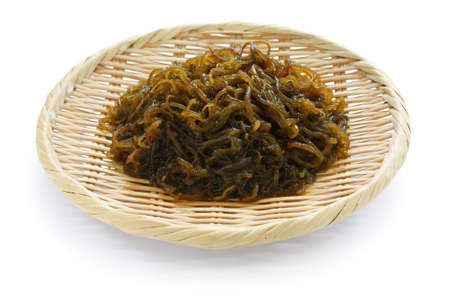okinawa: japanese edible seaweed, mozuku on a bamboo basket, healthy and diet food