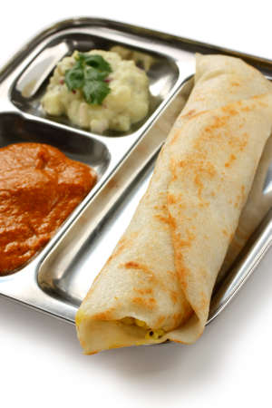 masala dosa, crispy crepe stuffed spiced potatoes, south indian food photo
