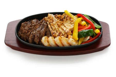 tex mex: beef chicken and shrimp fajitas Stock Photo