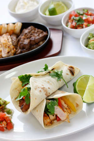 tex: beef chicken and shrimp fajitas, mexican cuisine Stock Photo