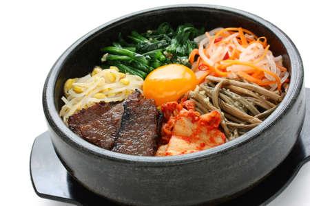 korea food: bibimbap in a heated stone bowl, korean dish