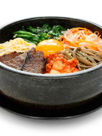 korean food: bibimbap in a heated stone bowl, korean dish