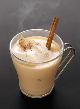 american dessert: steaming eggnog on a black background Stock Photo