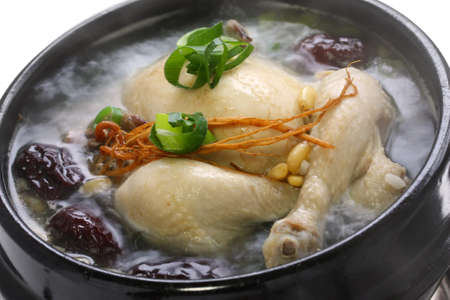 chicken soup: steaming samgyetang, chicken soup with ginseng, korean food Stock Photo
