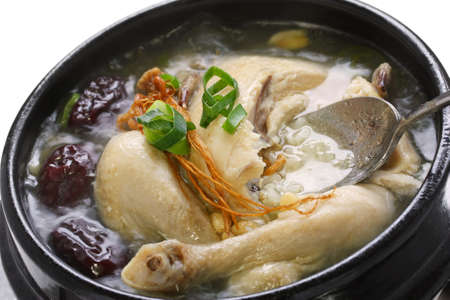 broth: steaming samgyetang, chicken soup with ginseng, korean food Stock Photo