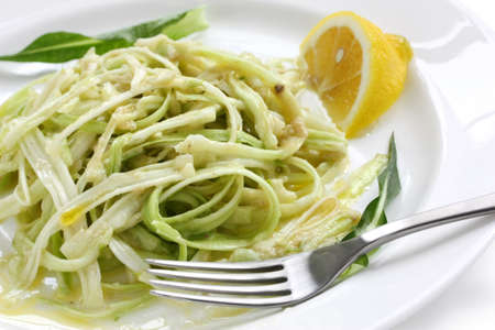 romana: puntarelle alla romana, asparagus chicory salad with anchovy dressing, italian food Stock Photo
