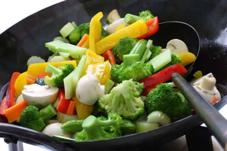 stir-fried vegetables in a chinese wok photo