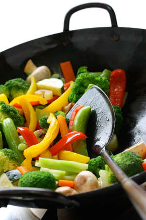 cooking utensil: stir-fried vegetables in a chinese wok