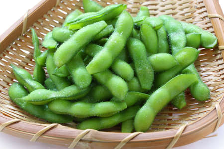 edamame nibbles, boiled green soy beans, japanese food Stock Photo - 13759504