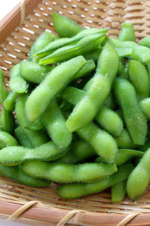 edamame nibbles, boiled green soy beans, japanese food photo
