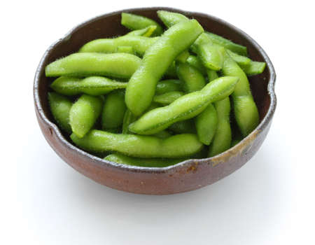 person appetizer: edamame nibbles, boiled green soy beans, japanese food