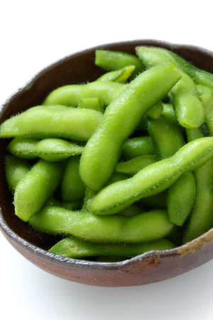 edamame nibbles, boiled green soy beans, japanese food Stock Photo - 13759503