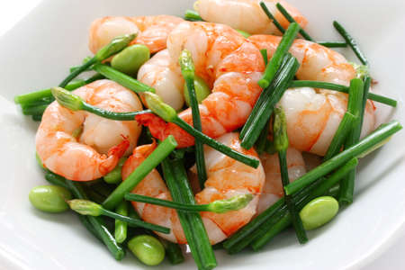chinese cuisine: stir-fry flowering chinese chives with prawns and edamame