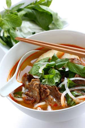 asian noodles: bun bo hue, a bowl of beef & rice vermicelli soup, vietnamese noodle cuisine
