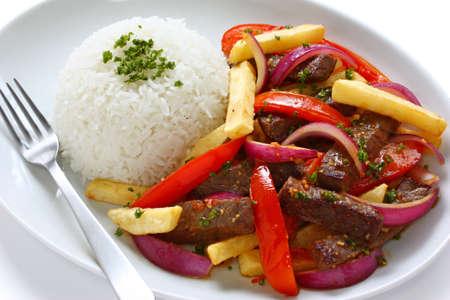 sauteed: lomo saltado, peruvian cuisine