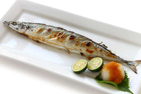 broiled: broiled pacific saury with salt, japanese cuisine Stock Photo