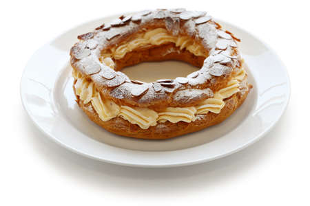 paris brest, choux pastry with praline cream, french bistro dessert photo