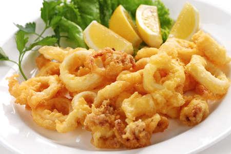 fried snack: fried calamari, fried squid with lemon