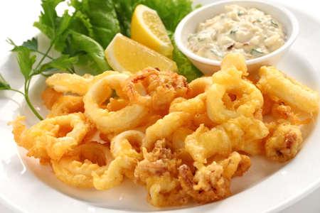 squids: fried calamari, fried squid with tartar sauce Stock Photo
