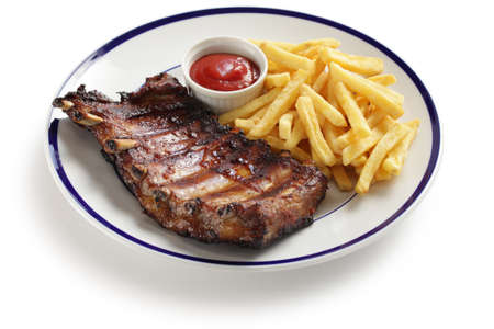 barbecued: barbecued pork spare ribs and french fries Stock Photo