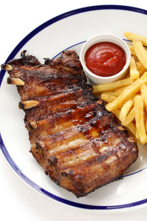 barbecued pork spare ribs and french fries Stock Photo