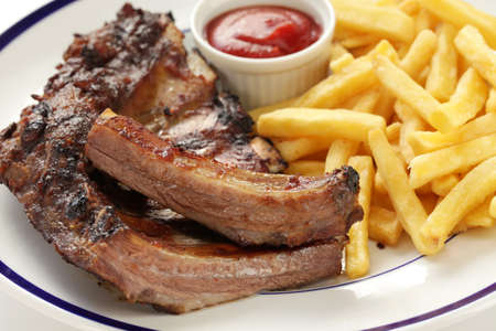barbecued pork spare ribs and french fries photo