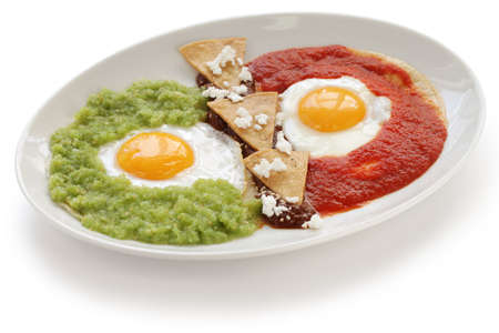 mexican food: huevos divorciados, fried eggs on corn tortillas with two salsas, mexican breakfast