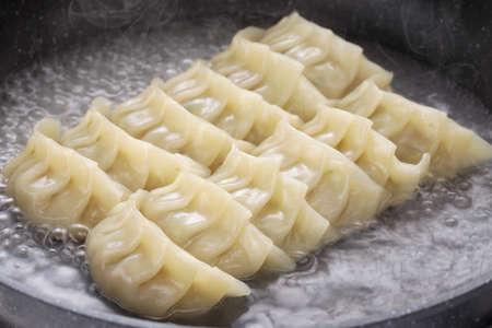 pan fried: cooking gyoza dumplings, potstickers, japanese food