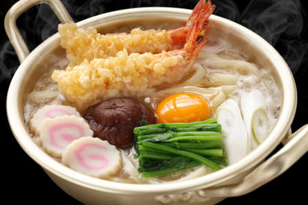 steaming nabeyaki udon, japanese hot pot noodles photo
