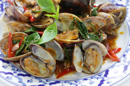 stir fried: stir fried clams with roasted chili paste and thai sweet basil, thai cuisine