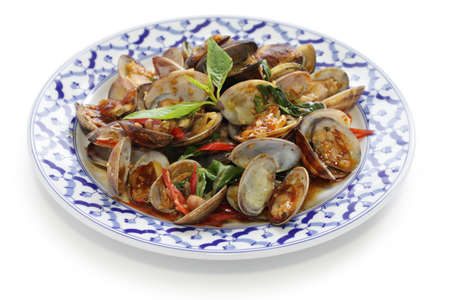 stir fried clams with roasted chili paste and thai sweet basil, thai cuisine photo