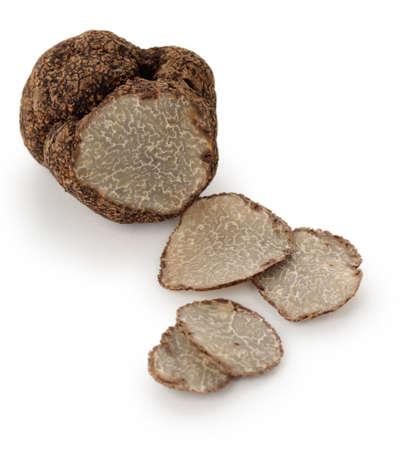 truffe blanche: truffe noire sur un fond blanc Banque d'images