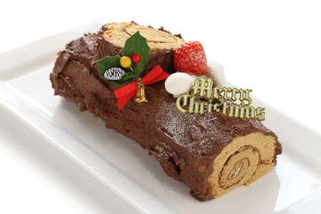 christmas cake: homemade buche de noel, chocolate yule log christmas cake Stock Photo