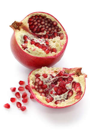 half cut pomegranate isolated on a white background photo