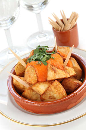 patatas bravas, fried potatoes with a spicy tomato sauce, spanish tapas cuisine photo