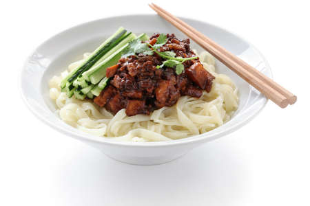 zha jiang mian, chinese cuisine, noodles topped with fermneted soy bean paste and fresh cucumber photo